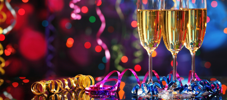 glasses of champagne with party decorations