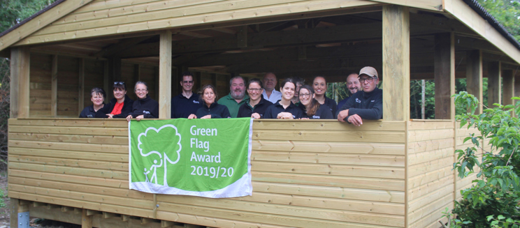 Forest Team wave the green flag in the Forest Shelter