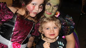 Three kids in fancy dress at our halloween disco