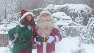 Santa and his elf in the recent snow, at the Enchanted Forest Grotto