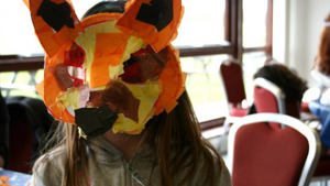 Child in a fox mask