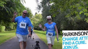 Walk for Parkinsons participants with Parkinsons UK Logo