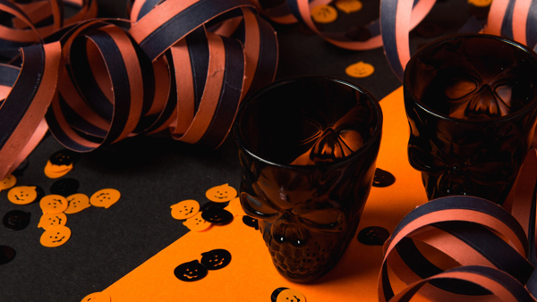 Black skull glasses on a Halloween party table