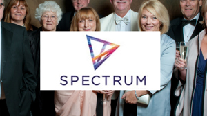 Spectrum team at a Ball with logo in front