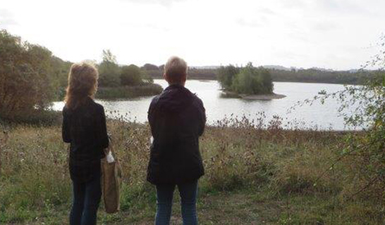 Two volunteers look out across the Park
