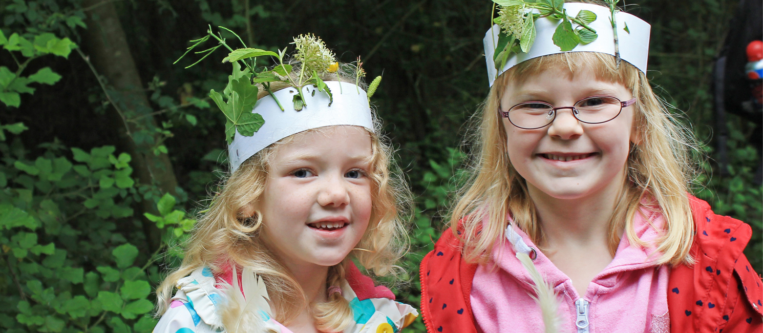 Tow girls with hand made leaf crowns in the Park