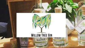 Bottles of gin with Willow Tree Logo in front