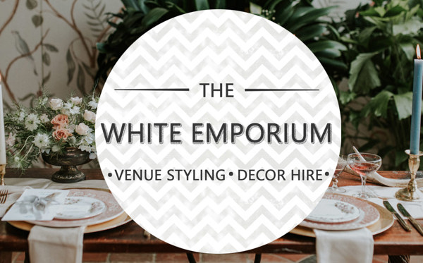 White Emporium logo sitting over a photo of a decorated table