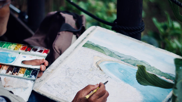 Someone painting an outdoor scene
