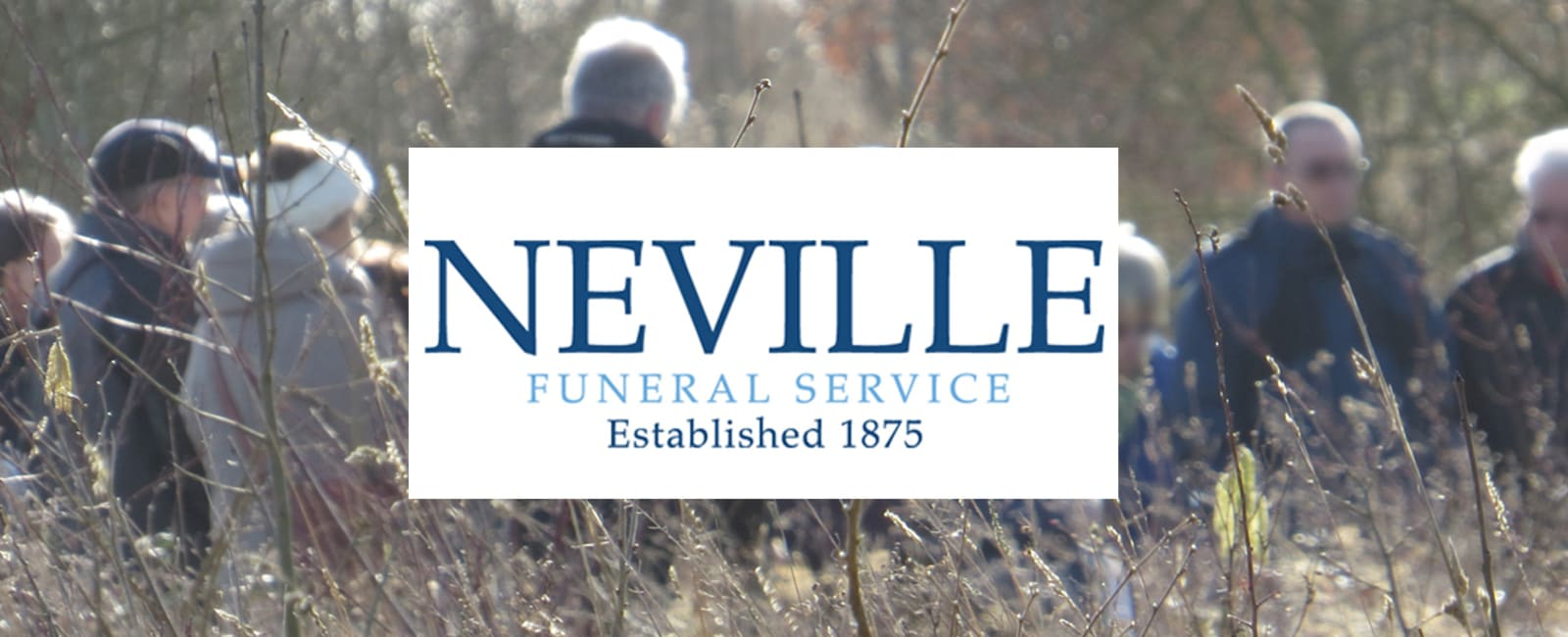 Neville tree planting with logo in front