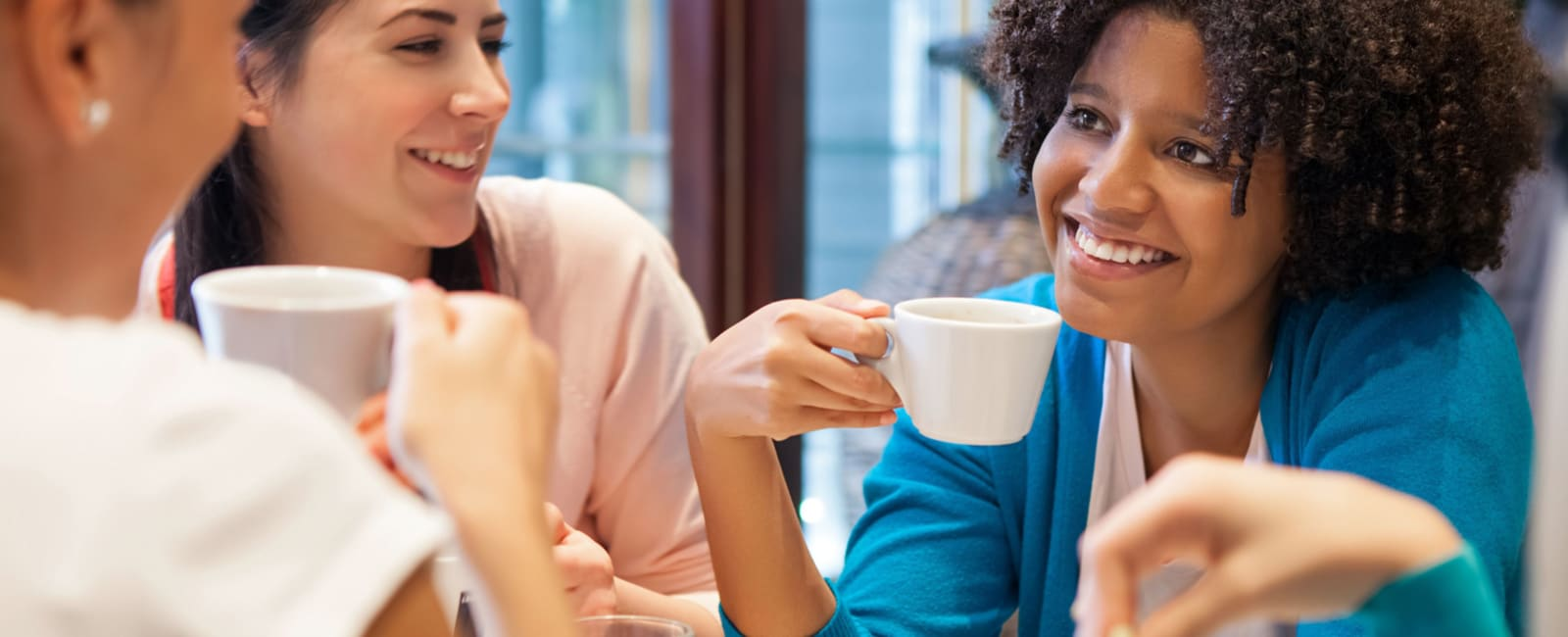 Group of female delegates drink coffee