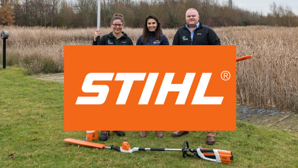 Staff being presented with new equipment with Stihl Logo in front