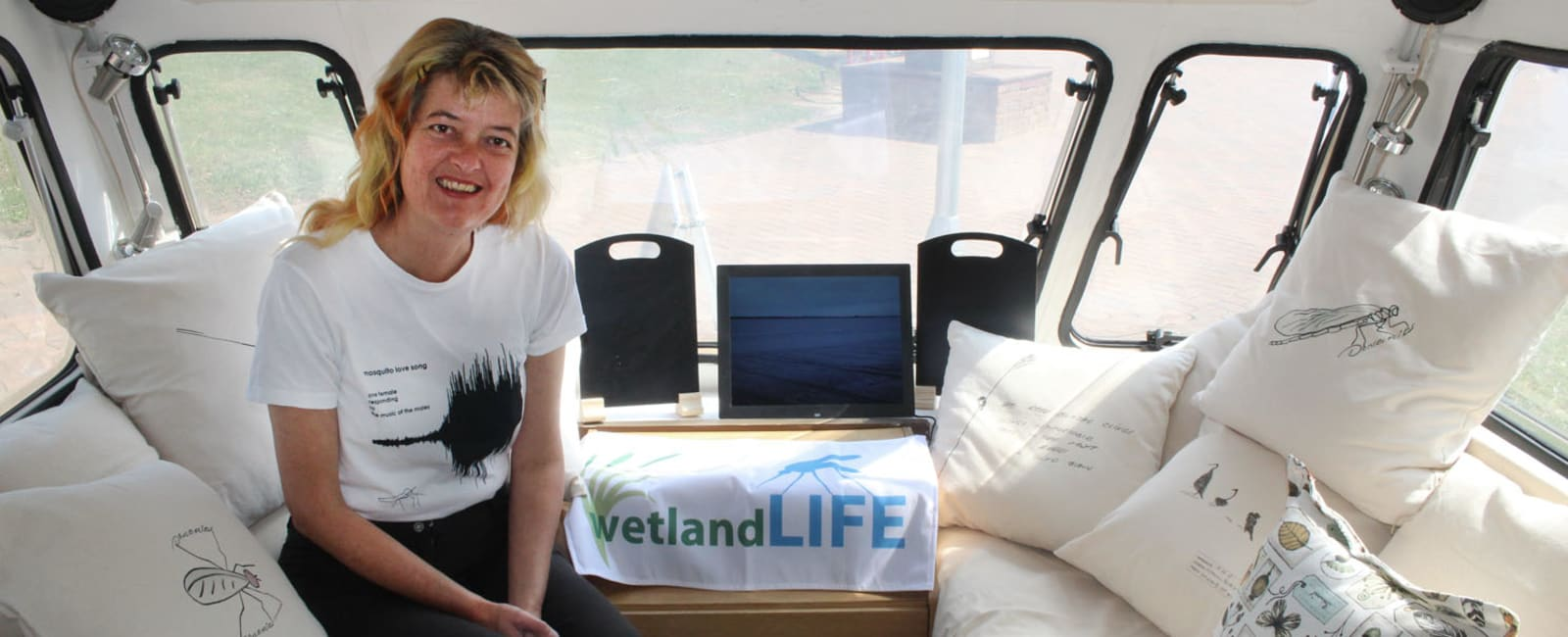 Dr Kerry Morrison in the wetlands on wheels caravan