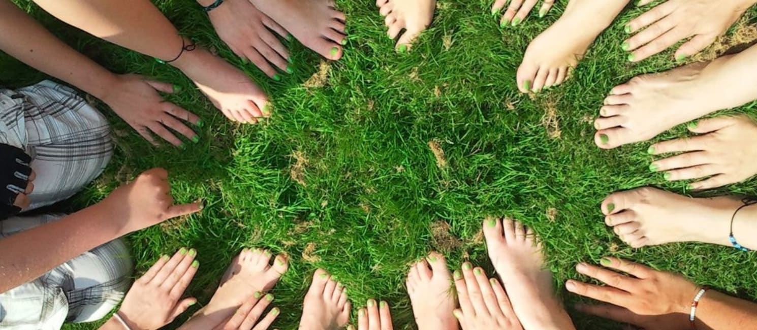 Feet in a circle on grass
